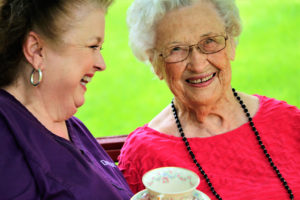 Beaumont home health client and caregiver sharing tea